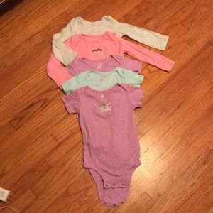 5 adorable Carters onesies in a size 24 mos.